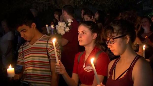 [NECN] Candlelight Vigil Held for Parkland Shooting Victims