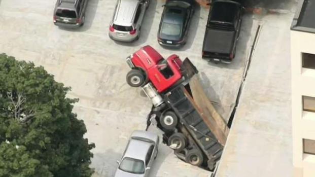[NECN] Dump Truck Making U-Turn Falls Through Quincy Parking Garage
