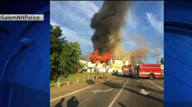 [NECN] Firefighters Taken to Hospital After Building Collapses