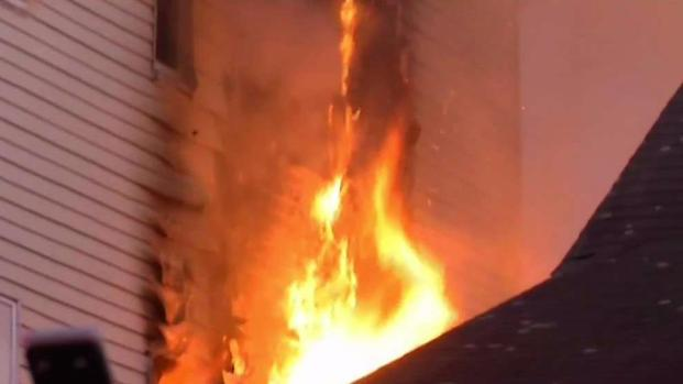[NECN] Mother and Child Saved From Roxbury Fire