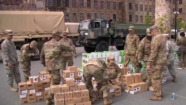[NECN] National Guard Helps Hand Out Space Heaters in Mass.