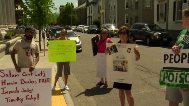 [NECN] Protesters Rally Against Salem Judge
