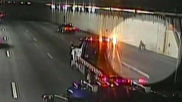 [NECN] Tow Truck Driver Shields Man in Wheelchair Inside Tunnel