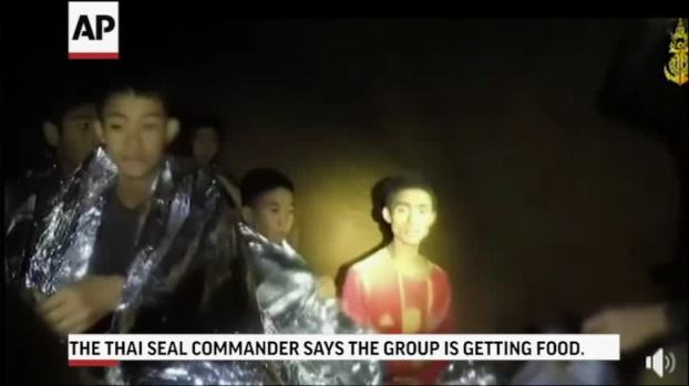 [NATL] Warm in Blankets, Thai Boys Smile, Joke With Rescuer in Cave