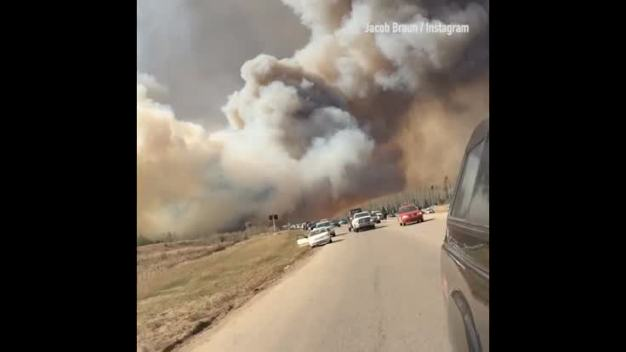 Wildfire Spreads Across Canada's Oil Sands Region