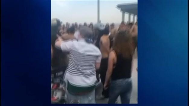 Police Break Up Beach Fight