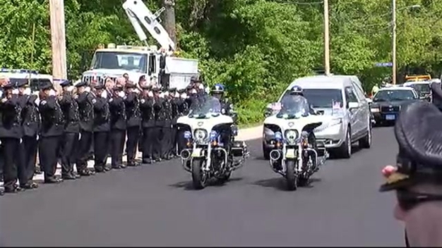 WATCH: Procession for Slain Police Officer Ahead of Wake