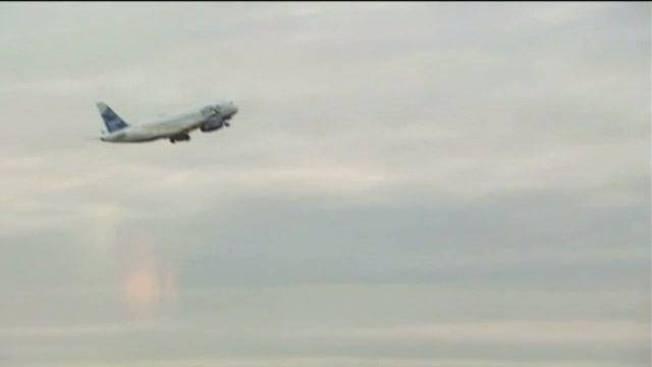 Plane Slides Into Snow on Runway at NYC JFK