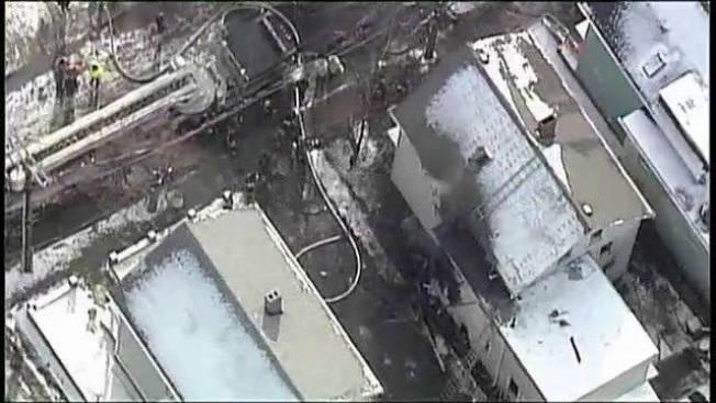 Firefighters Battling 2-alarm Fire in Somerville, Mass.