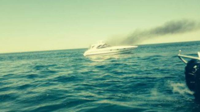 2 Men Rescued After Their Boat Catches Fire