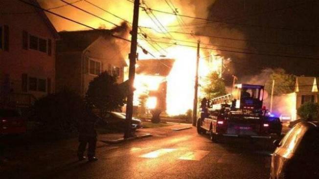4-alarm Fire Spreads Between 2 Buildings