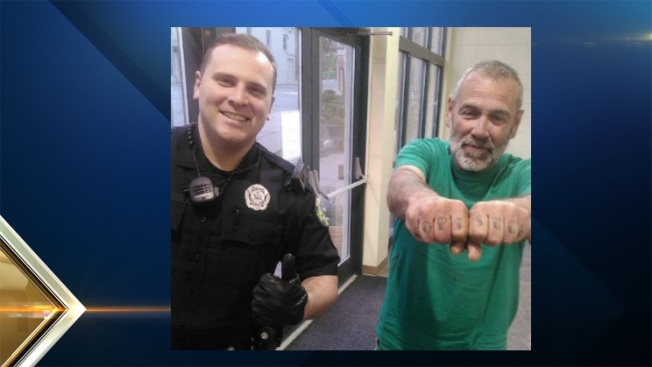 Man With 'Cops Suck' Tattoo Poses With Police in Bangor, Maine