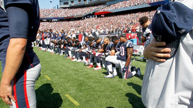 Some NE Patriots Protest Trump's Comments By Taking A Knee
