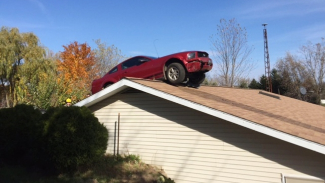 Owner Hears 'Kaboom,' Finds Car on Roof of Home