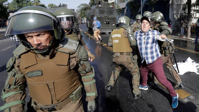In Chile, Pope Met by Protests, Threats, Burned Churches