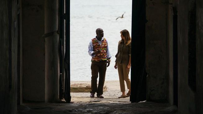 In First Solo International Trip, Melania Trump Walks Through Ghana's 'Door of No Return'