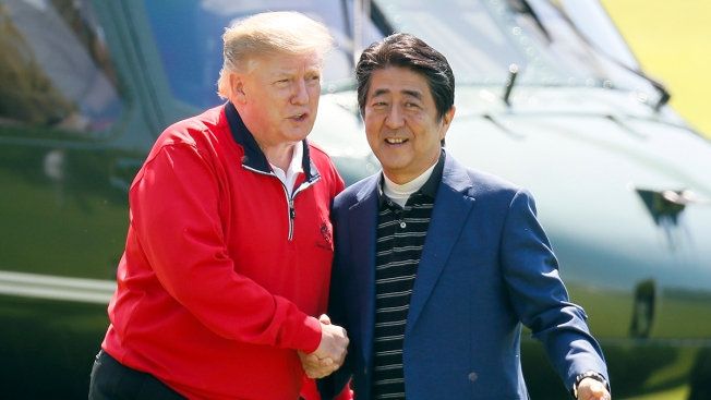 Amid Trade Tensions, Trump and Abe Tee Off