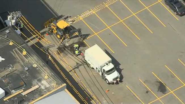 Crews Tend to Gas Line Break in Cambridge
