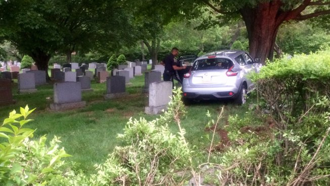 SUV Crashes Into Conn. Cemetery