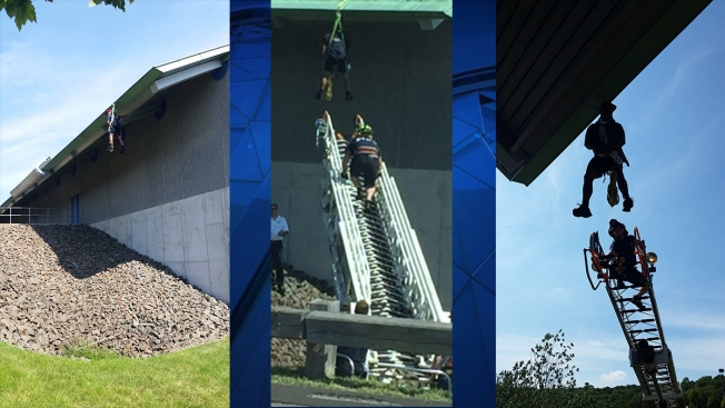 Worker Slips, Dangles From Sports Complex