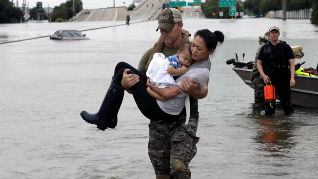 Photo of Mother and Baby's Rescue Becomes Symbol of Storm