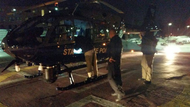 Mass. Trooper Hangs from Helicopter in Icy River Rescue
