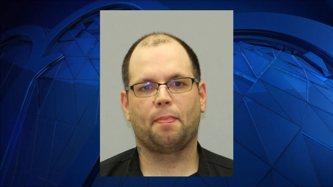 Police: Man Tried to Take Photos Up Woman's Skirt