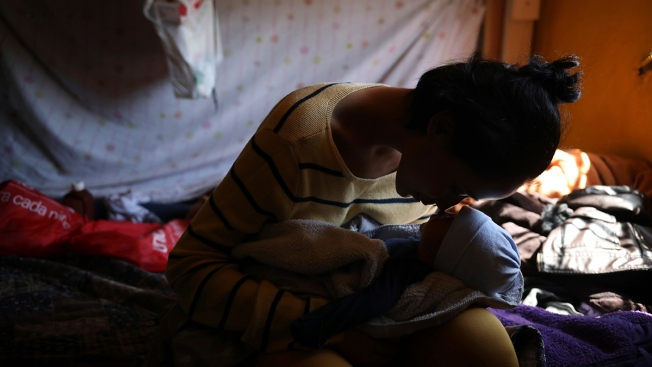 Teen Mom, Newborn Eye New Life From Tijuana Migrant Shelter