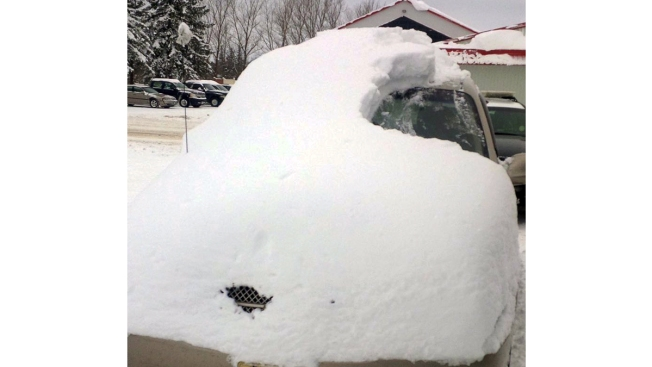 Man Charged for Driving Car Almost Completely Covered in Snow