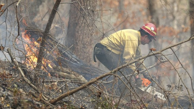 Wildfires continue to rage across the South, scorching more than 100000 acres