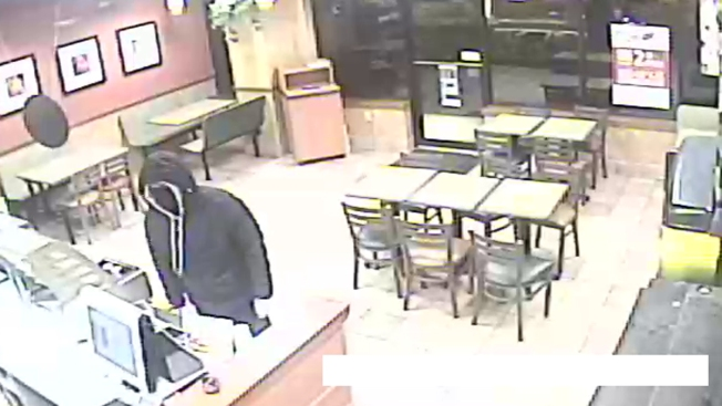 Police Seek Suspect in Armed Robbery