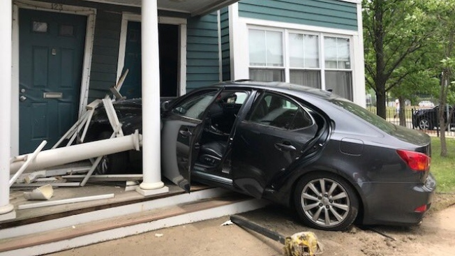 Car Smashes Into Front of Roxbury Home