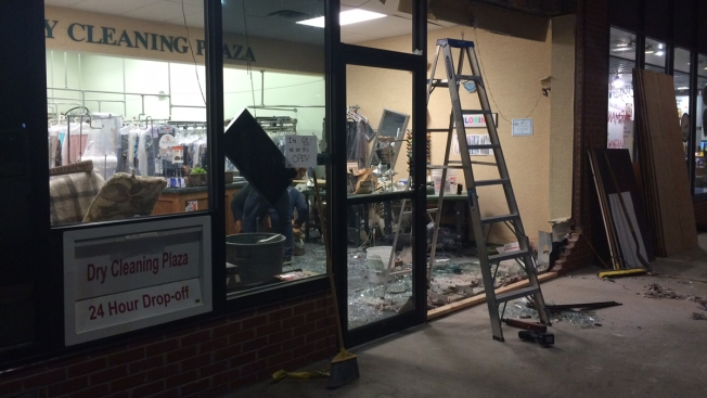 SUV Crashes Into Dry Cleaner