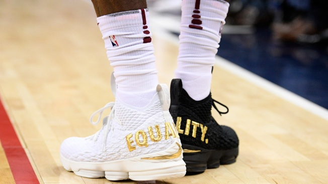 8dee1781f73c LeBron Wears 1 Black Shoe