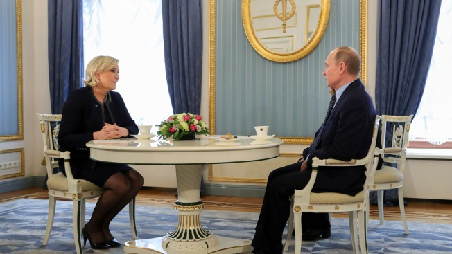 Putin Meets Le Pen, Denies French Election Interference