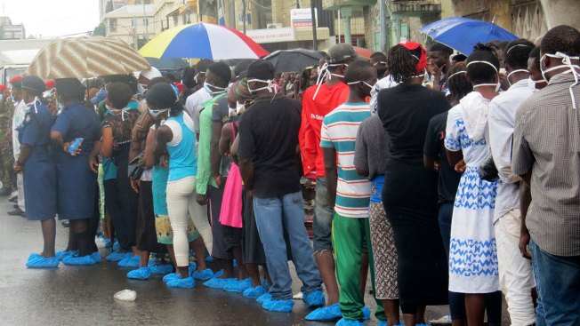 Families Wait in Rain to ID Lost Loved Ones in Sierra Leone