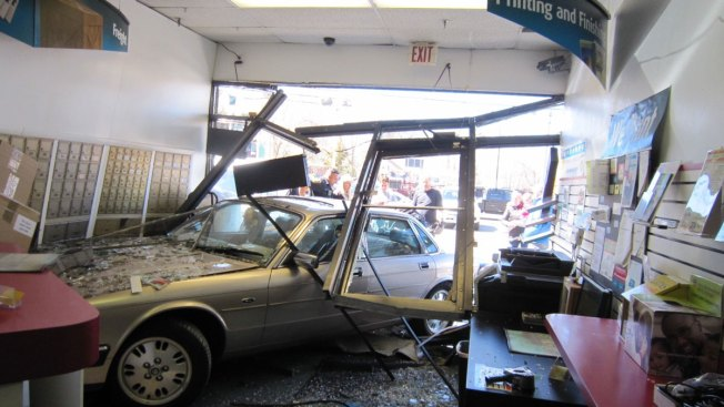Car Barrels Through Front Windows of Store