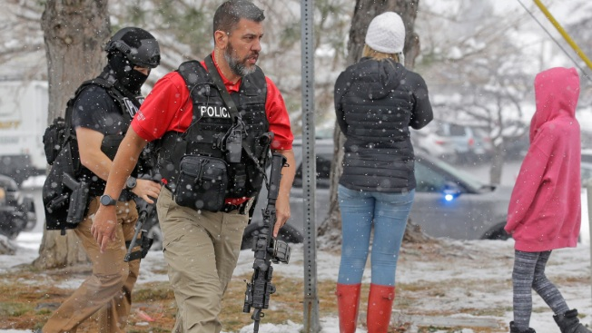 Gun-wielding student at Utah school disarmed by his mum