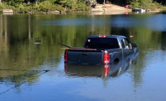 Dog Puts Idle Truck Into Gear, Sends It Into Lake