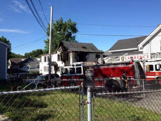 Police: Woman Stabs 1 Person, Sets House on Fire