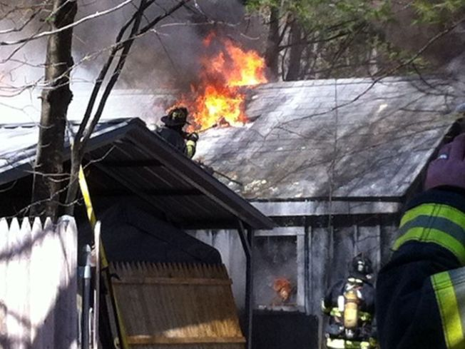 Grill Fire Damages Garage, Car