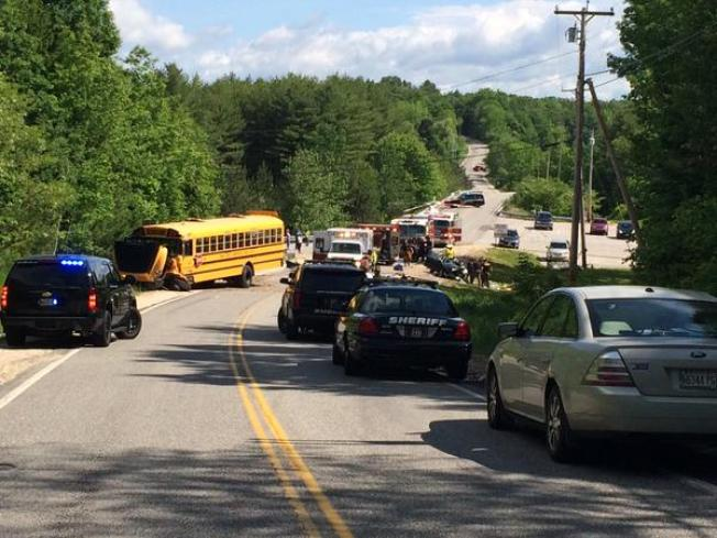 Vehicle Hits School Bus; Driver Suffers Life-Threatening Injuries