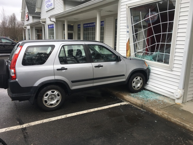 Car Slams Into Building in Carver