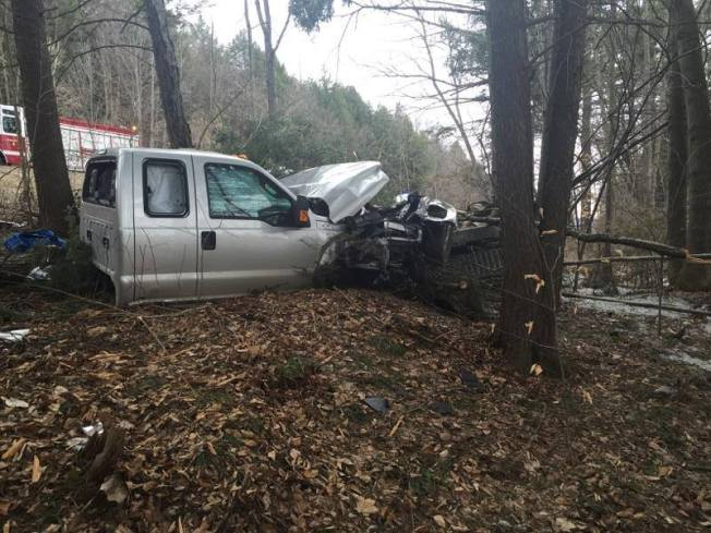 Truck Hits Tree, Snaps Into 2 Pieces