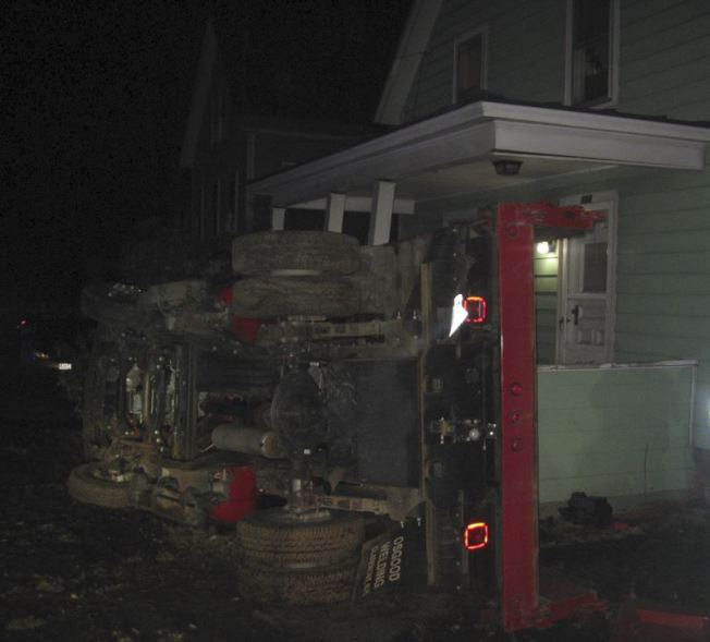Stolen Truck Careens Into House, Driver Arrested