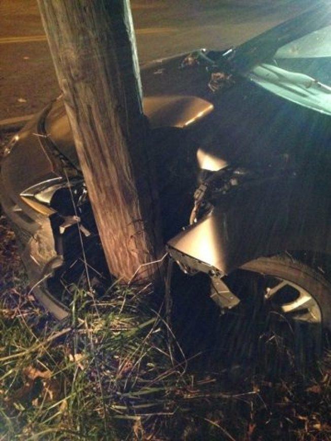 Man Charged with Drinking, Texting While Driving After Crashing Into Telephone Pole