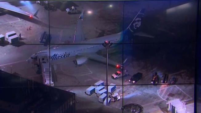 Plane collides with parked truck on Logan Airport taxiway
