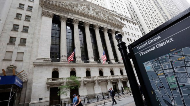 Dow Closes at Record High in Wild Session