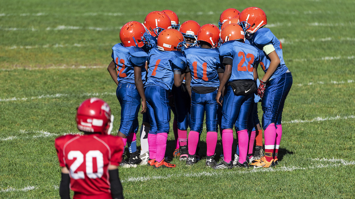 An undated file photo of young boys in the huddle during a Pop Warner  football game 519b72a9e